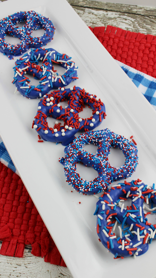 Pretzels covered in blue candy coating and sprinkles