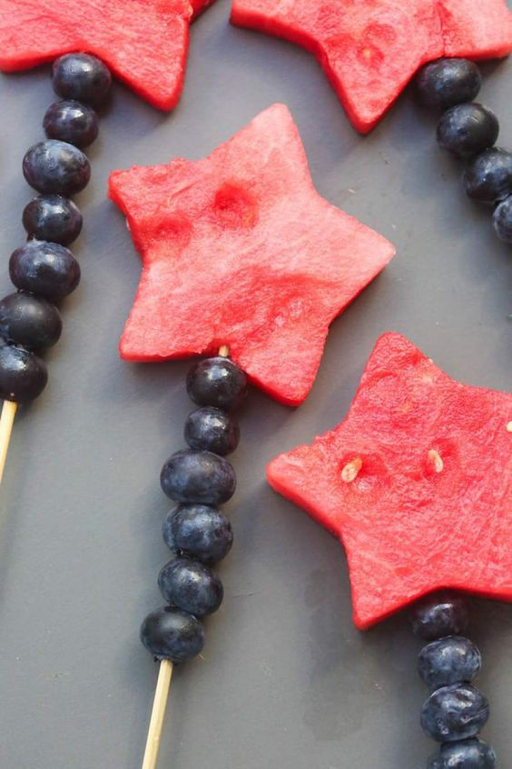 Watermelon cut in star shape on kabobs with blueberries