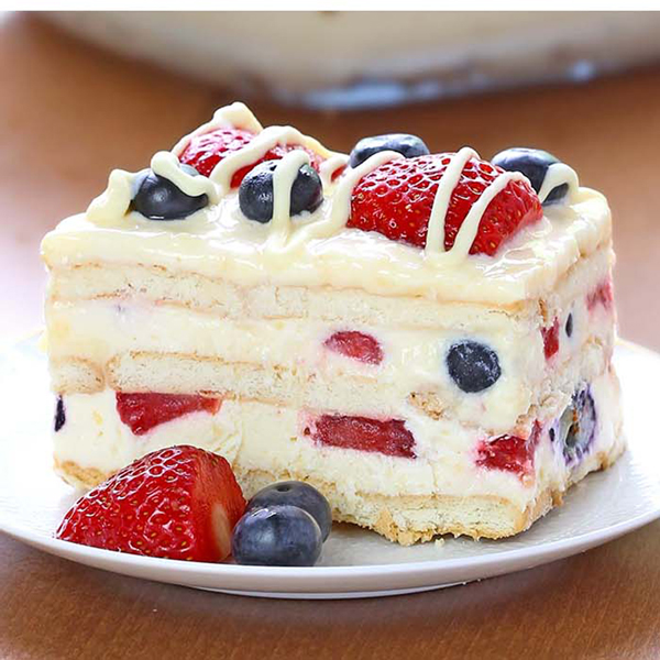Layered summer berry icebox cake on a plate