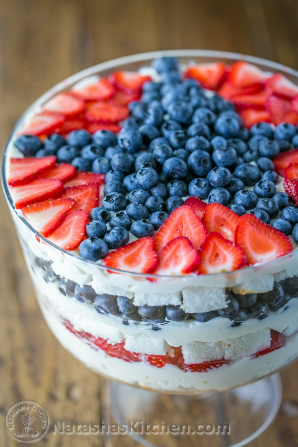 Layered fruit trifle with blueberries and strawberries in the shape of a star on top
