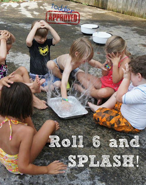 A group of children playing a game where they splash one another with water