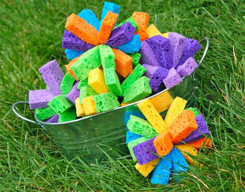 Water bombs made from sponges in a metal bowl on the grass