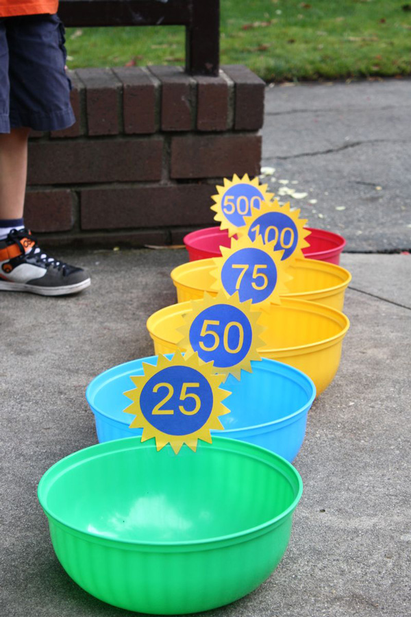 A row of bowls set up for water balloons to be thrown into, with the closest bowl earning 25 points and the furthest bowl earning 500 points