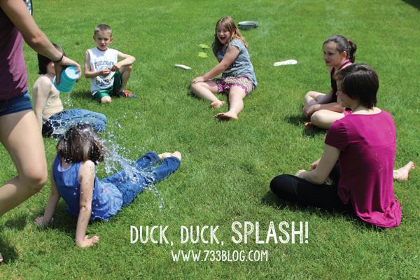 Kids sitting on the grass playing duck, duck, splash