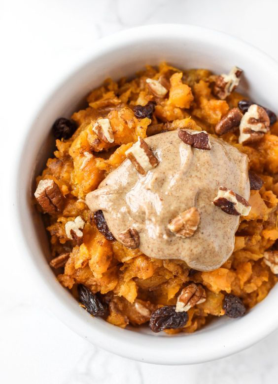 Sweet potato breakfast bowl with chopped nuts