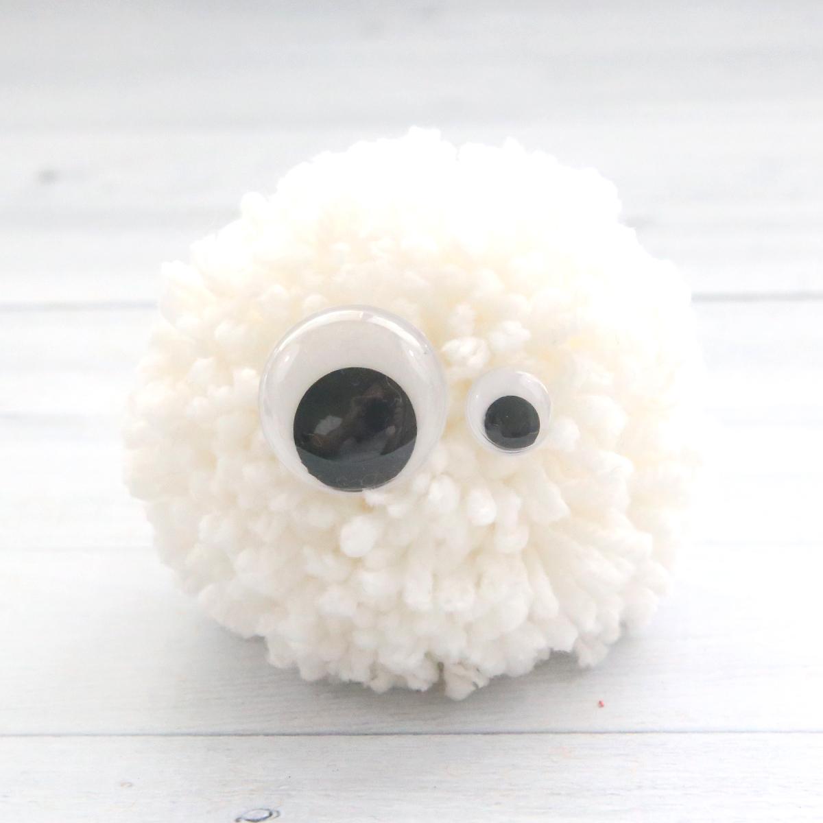 Ghost yarn pom pom