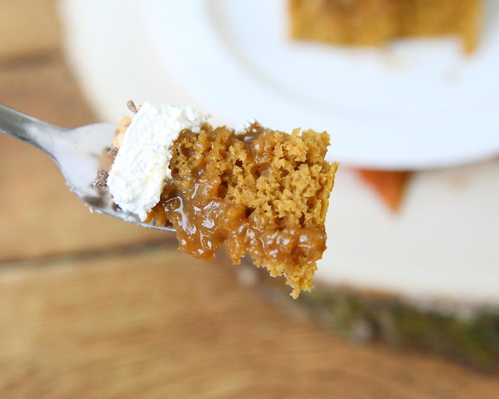 A bite of pumpkin caramel poke cake on a fork