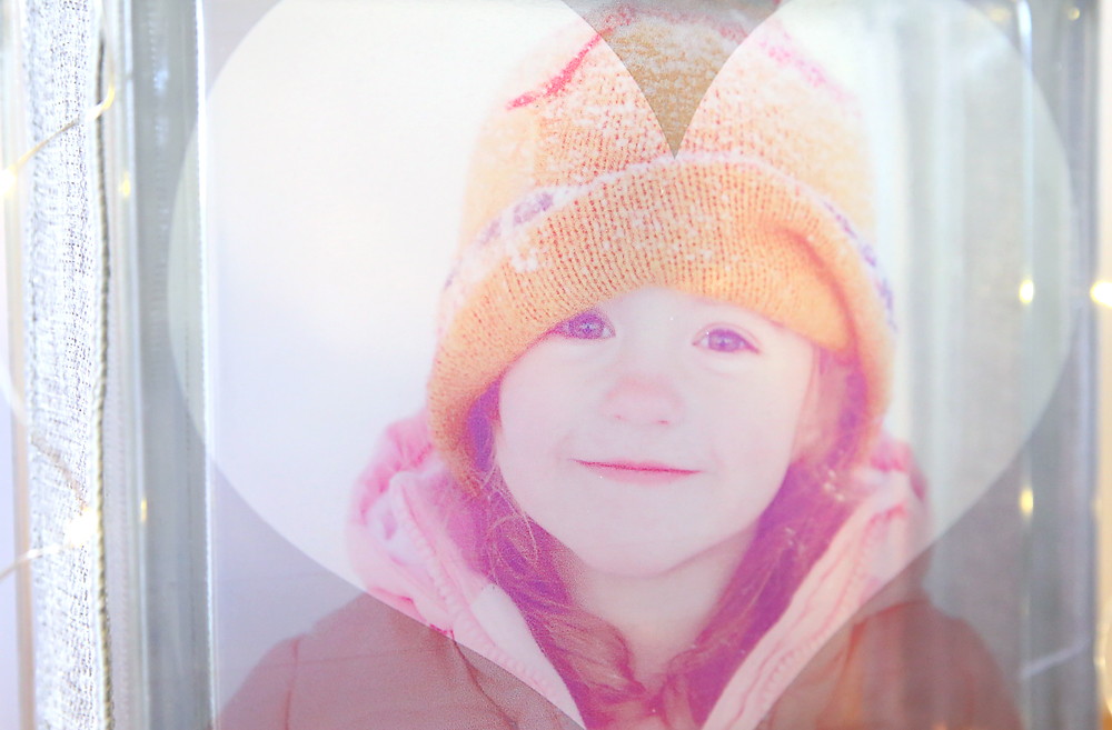 Photo of a little girl wearing snow clothes