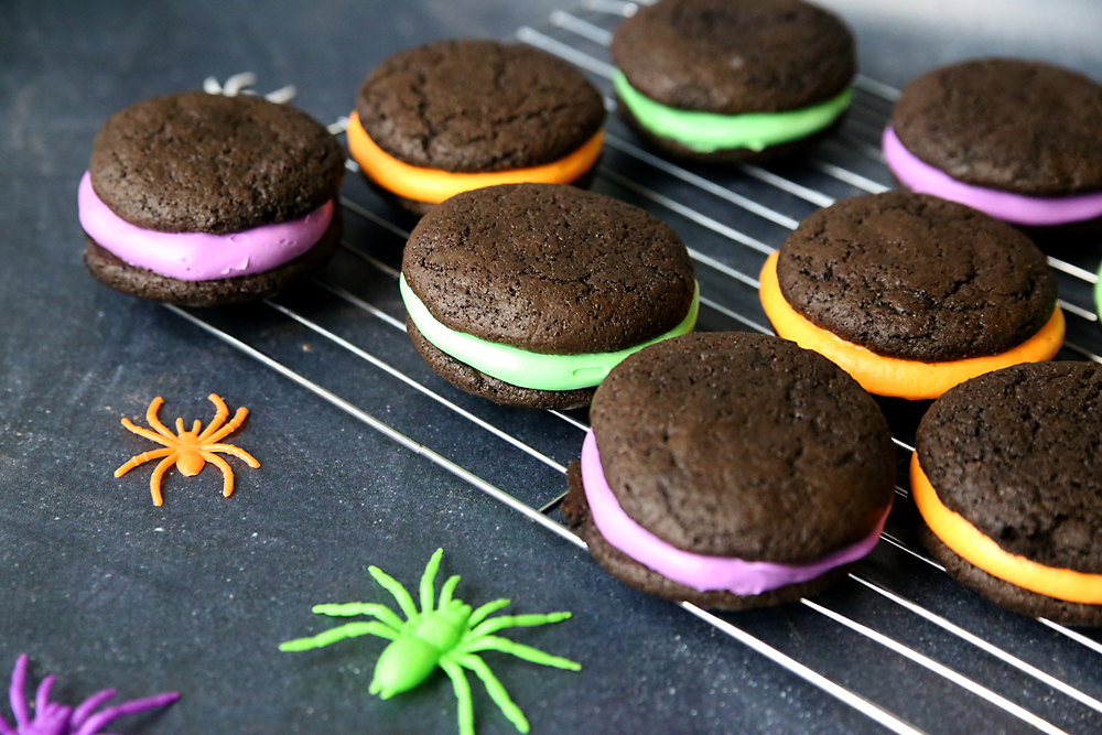 halloween whoopie pies: chocolate cookies sandwiched around yellow, green or purple frosting