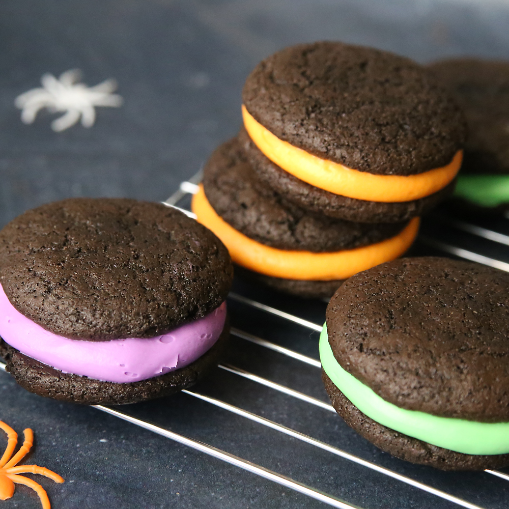 Chocolate whoopie pie cookies with orange, green and purple frosting