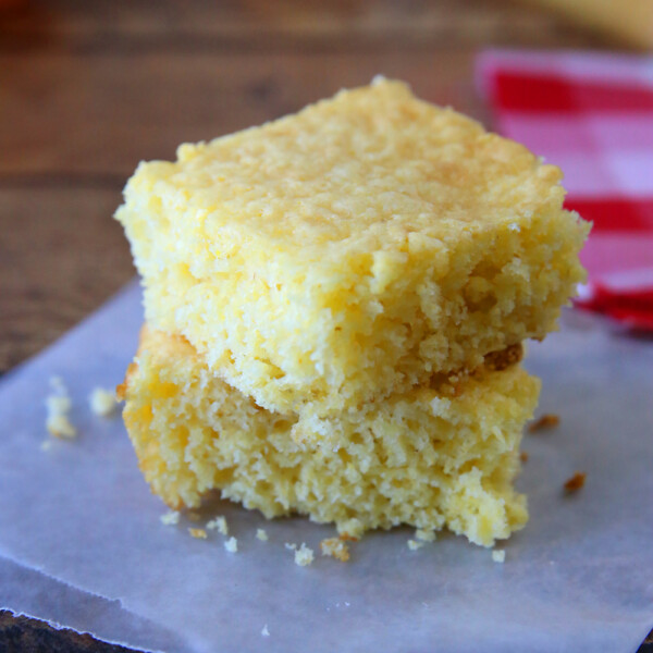 Two pieces of Jiffy cornbread stacked on a plate