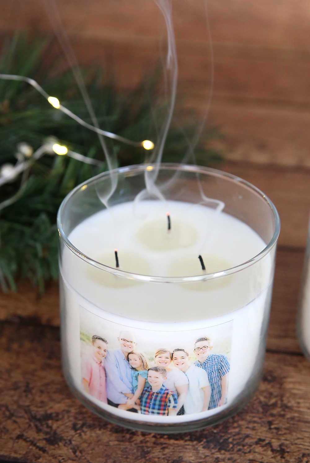 Personalized photo candle that has just been blown out; smoke coming from wicks