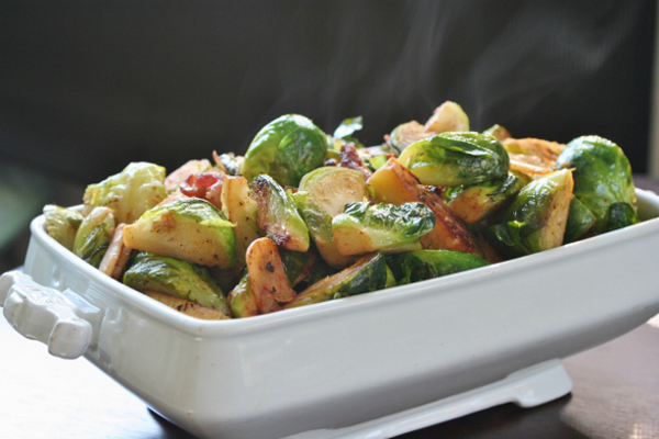 A tray of brussel sprouts with bacon for Thanksgiving
