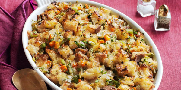 Thanksgiving stuffing in a white serving dish