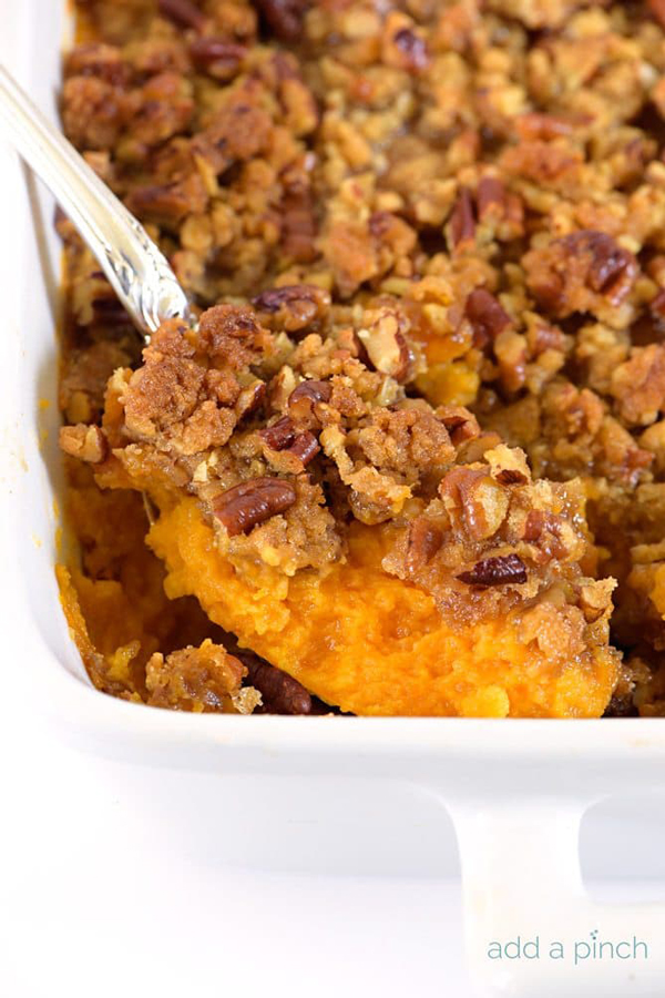 A close up of sweet potato casserole topped with nuts