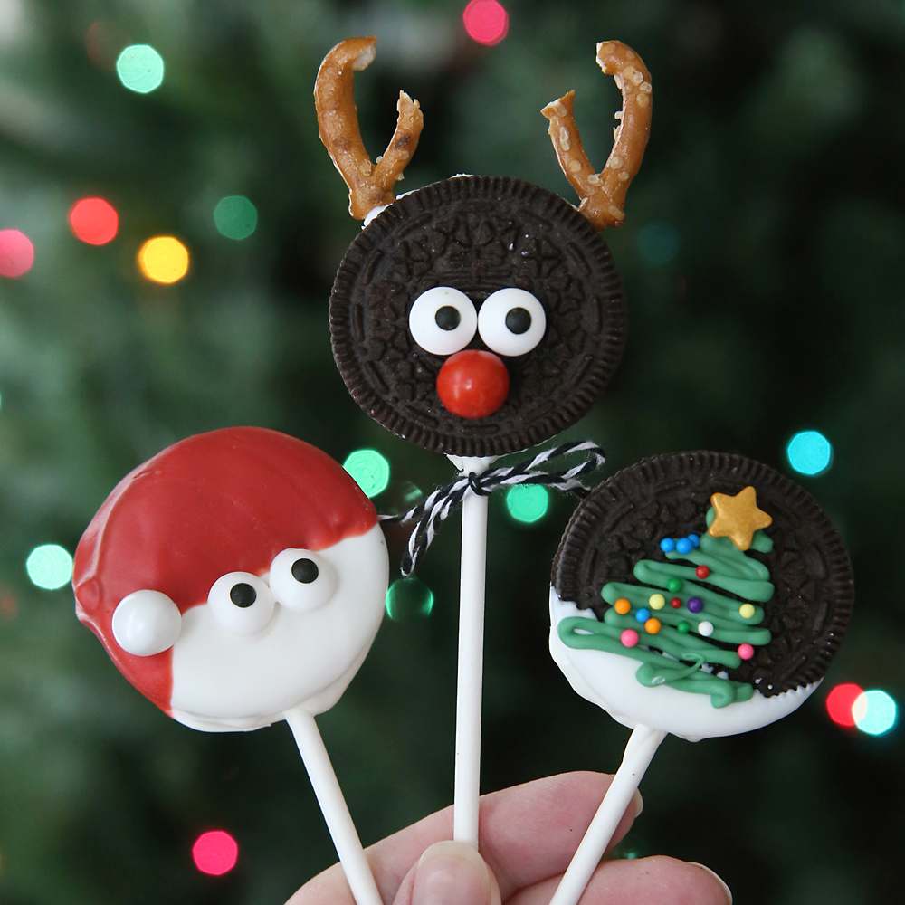 Christmas oreo pops decorated to look like Rudolph, Santa and christmas tree
