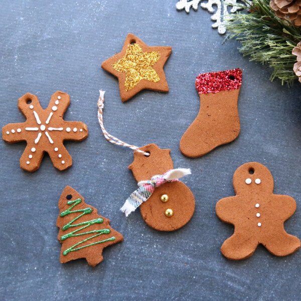 Cinnamon Christmas ornaments decorated with puffy paint and glitter