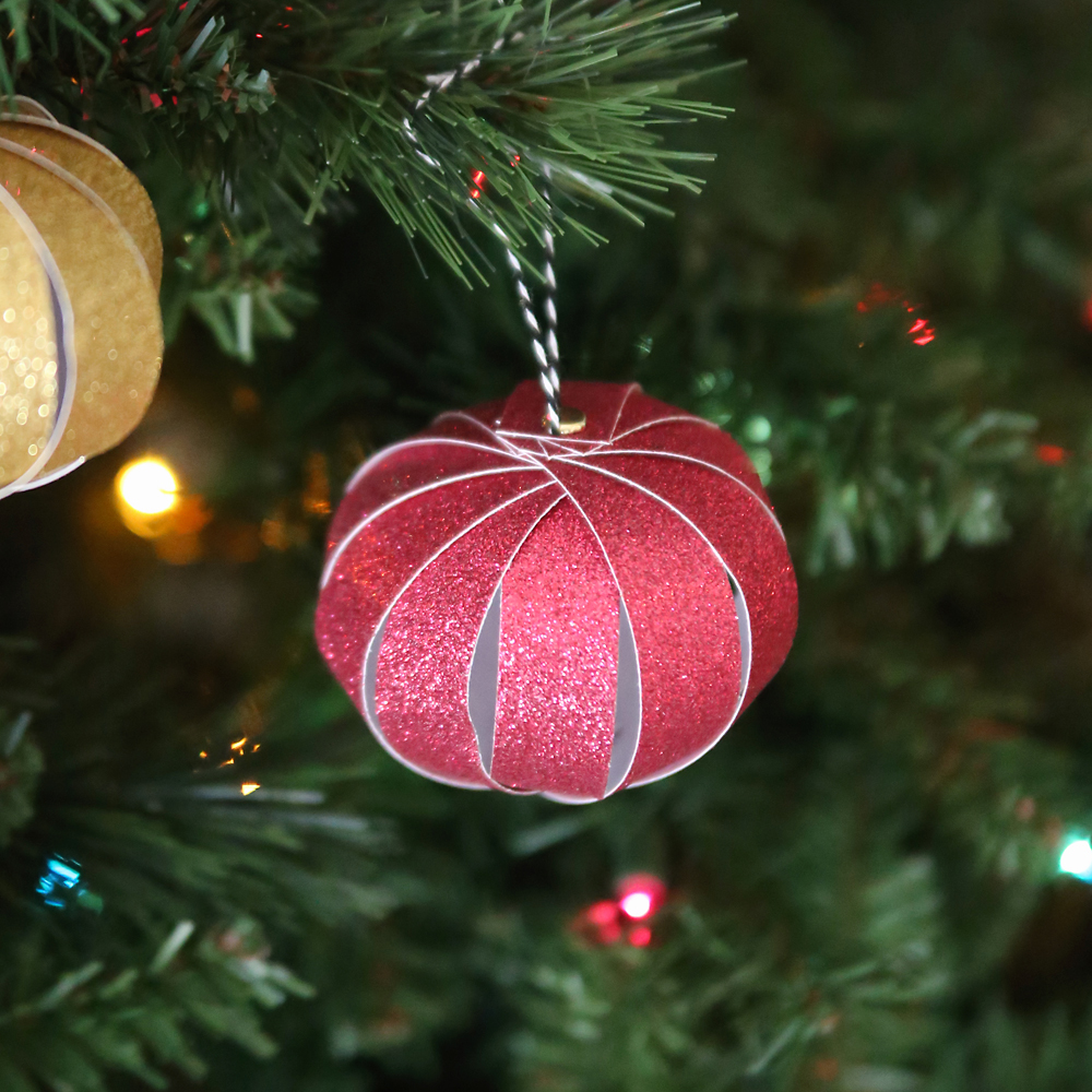 These pretty ornaments are made out of strips of scrapbook paper! I have so much old scrapbook paper laying around I need to make these! Easy enough for kids with a free template.