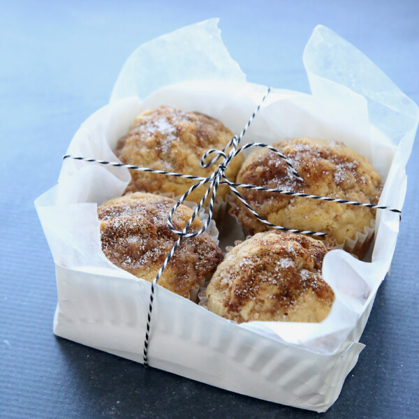 paper plate basket with muffins in it