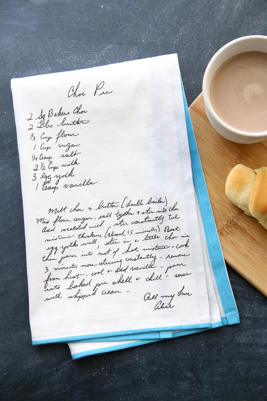 Kitchen towel with handwritten chocolate pie recipe printed on it