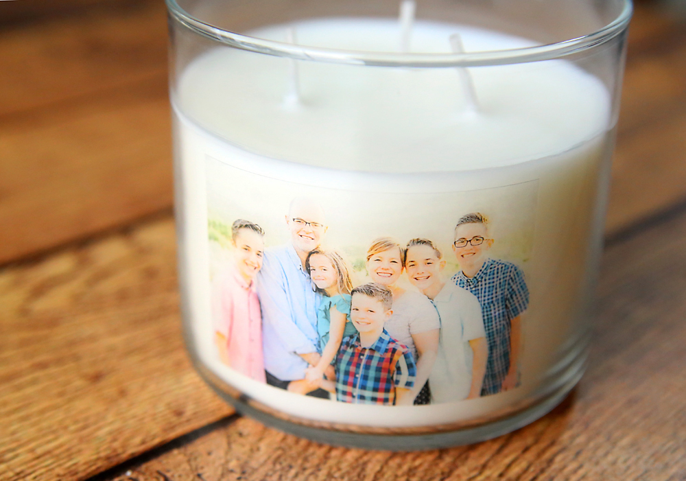 White jar candle with photo on it