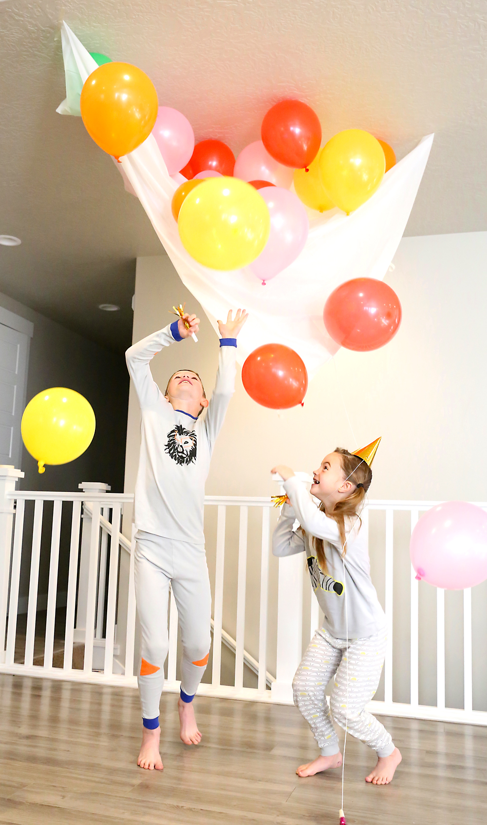 Kids playing with the balloon drop