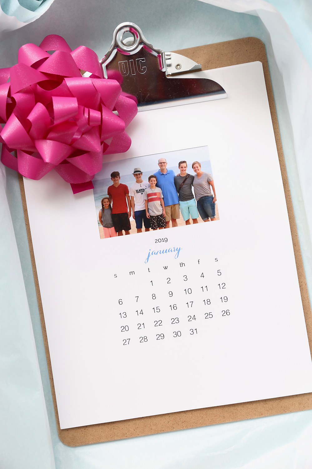 Photo calendar with a bow in a gift box