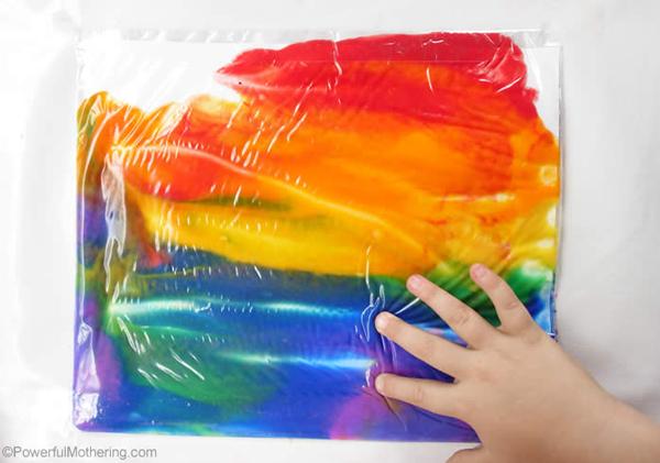 Paper and paints inside a large ziplock bag