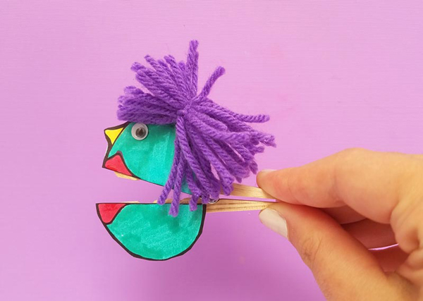 Fun activity for kids: clothespin decorated with colored paper and yarn