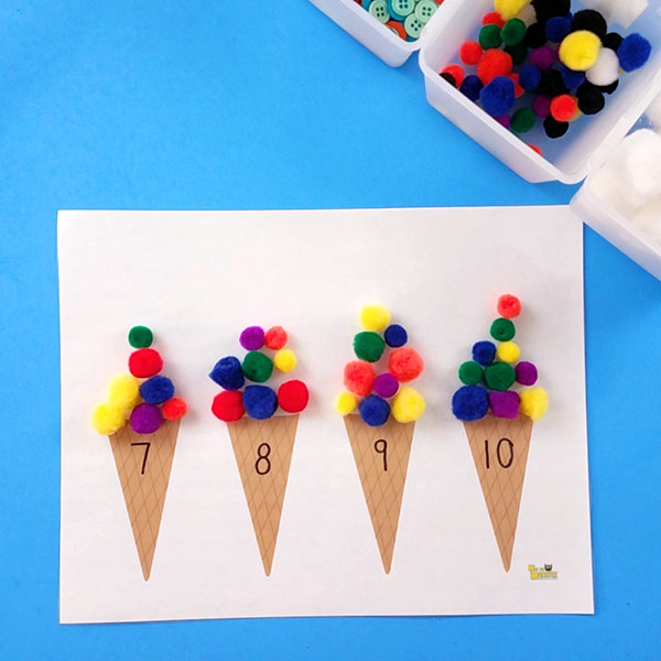 Kids counting activity: paper ice cream cones with numbers and colored pom poms