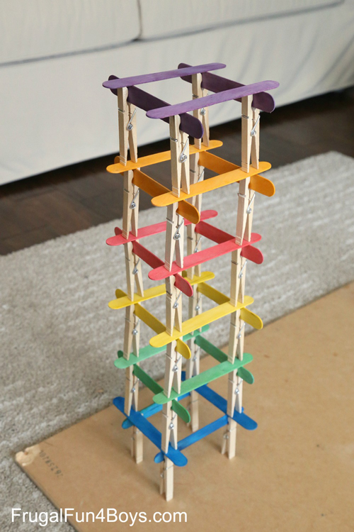 Kid activity tower built from popsicle sticks and clothespins