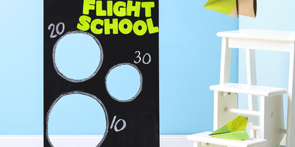 Board with circles cut out of it to send paper airplanes through