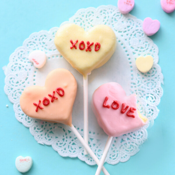 Cake pops decorated to look like conversation hearts