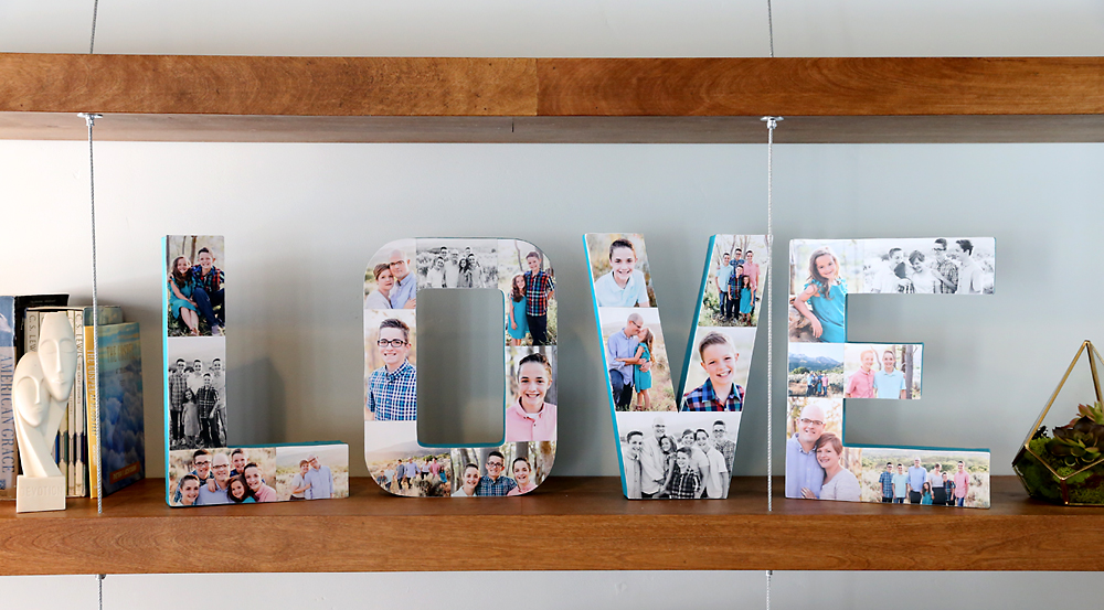 Paper mache letters that spell the word LOVE covered in photos on a shelf