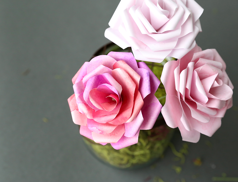 Learn how to make paper roses with these beautiful paper rose templates. Step by step instructions included. How to make DIY paper flowers.