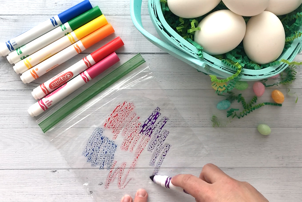 Easy Easter egg decorating for kids. These gorgeous watercolor Easter eggs are made with Crayola markers and ziplock bags! So much easier than paint or dye. DIY Easter egg decorating ideas.