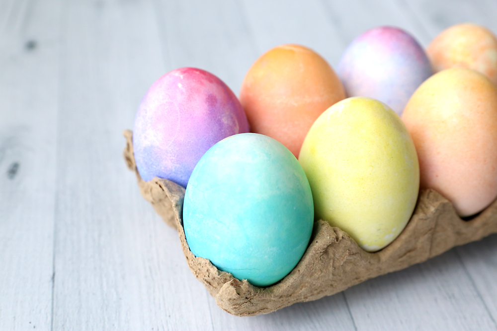 Watercolor eggs in an egg carton