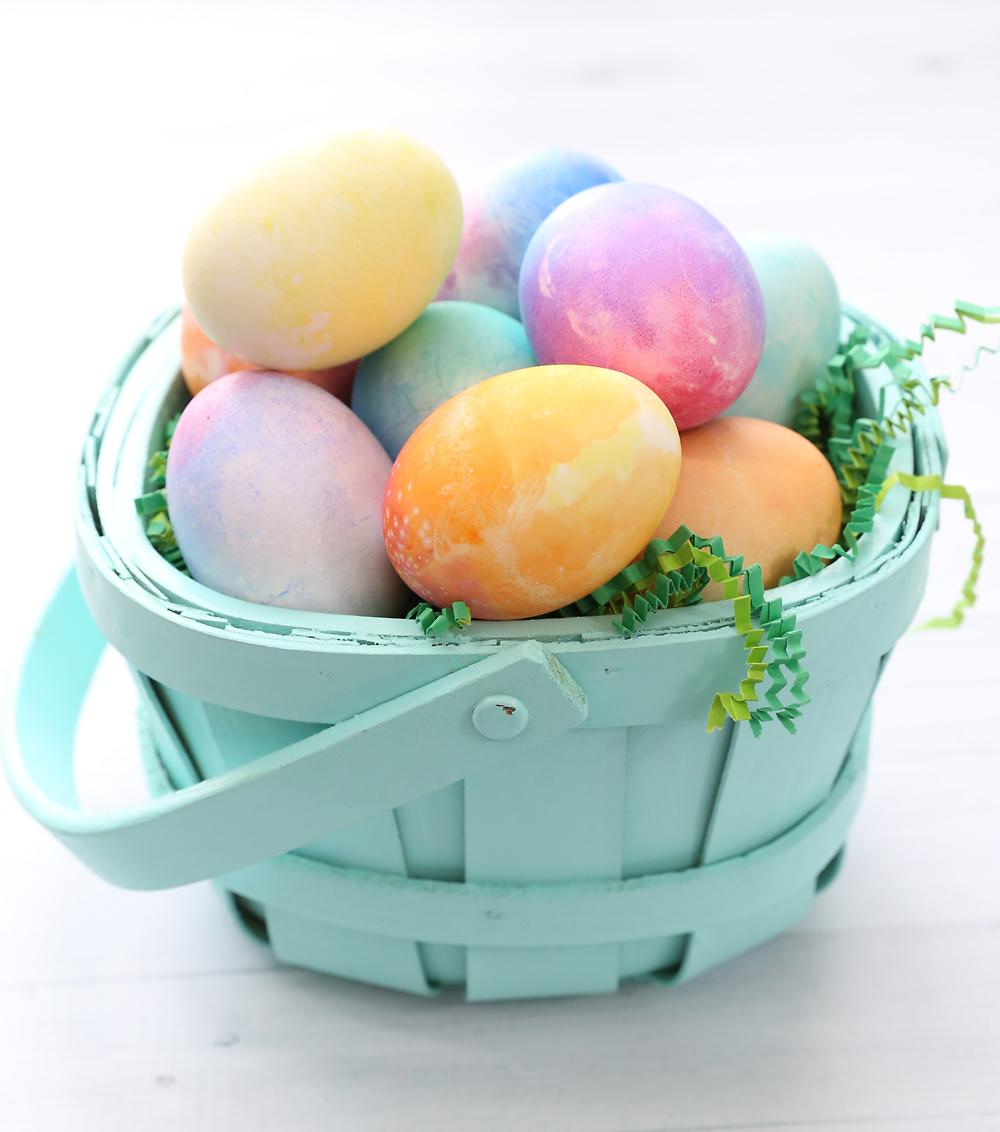 Watercolor Easter eggs in a basket