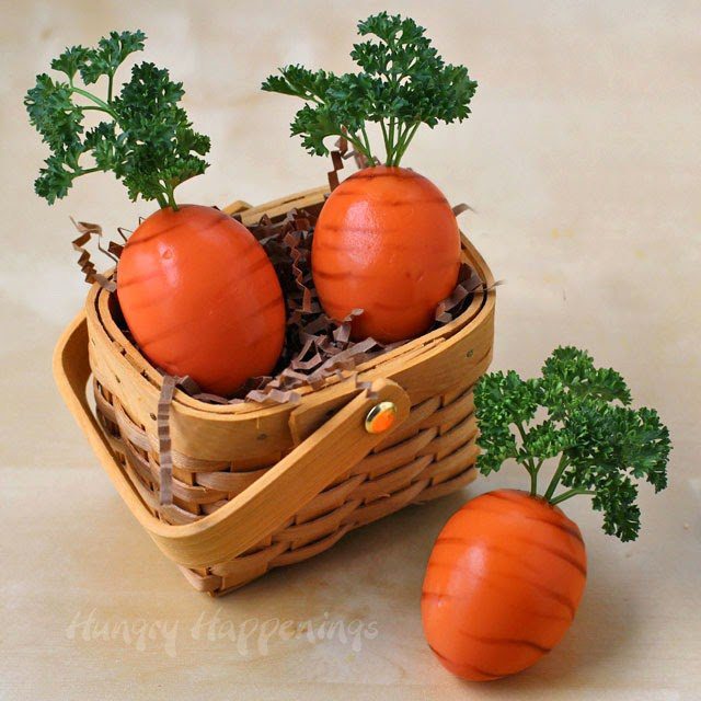 Easter eggs decorated to look like carrots in a basket