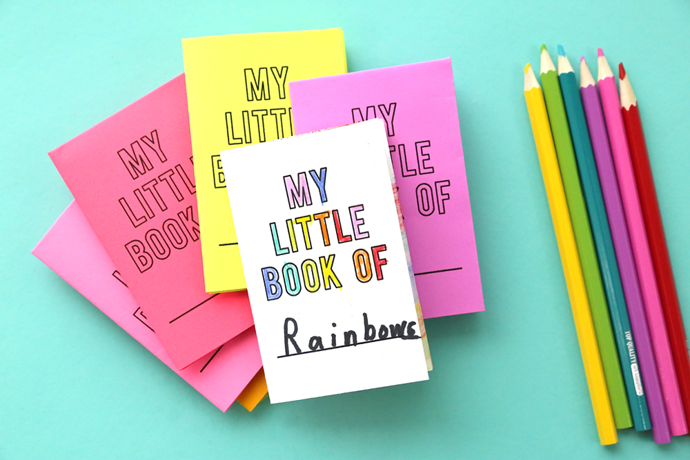 Stack of little paper books in different colors