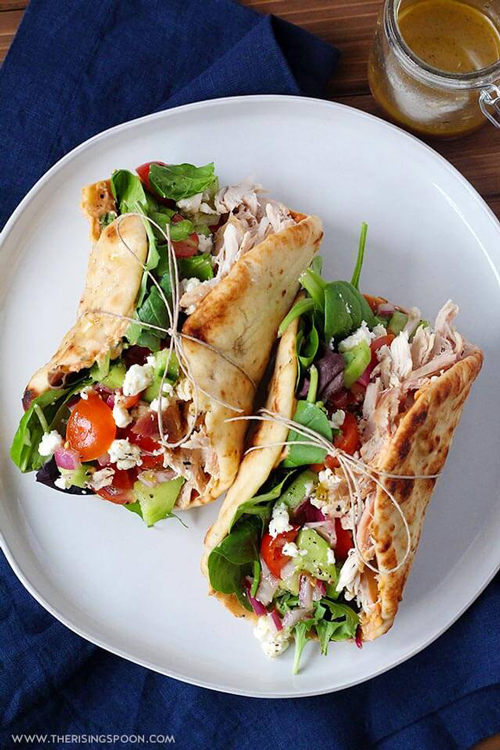 Chicken hummus naan wraps on a plate