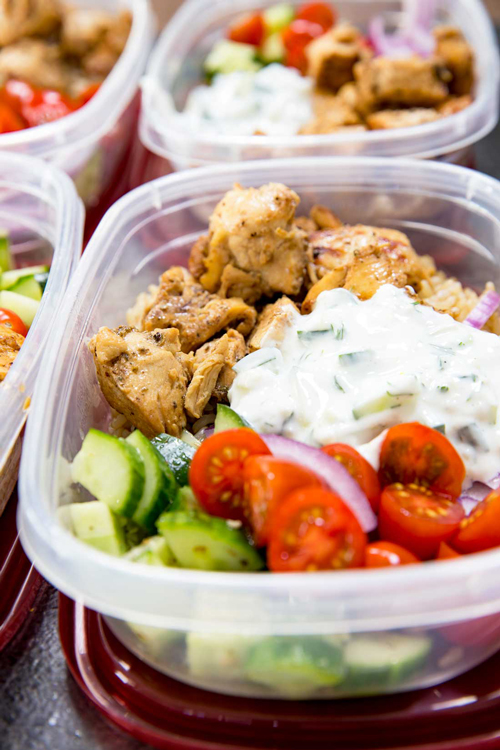 Greek chicken bowl with yogurt sauce, cucumbers and tomatoes