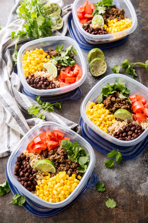 Taco meal prep bowls with taco meat, corn, tomatoes, beans, and rice