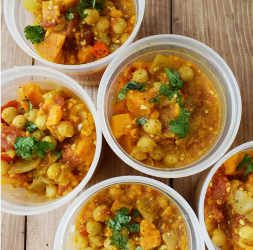 Coconut curry sweet potato stew in plastic bowls