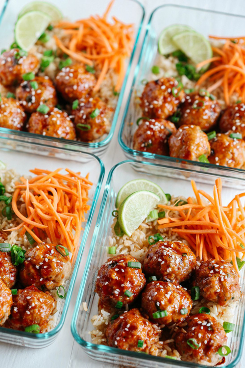 Honey sriracha glazed meatballs with rice and grated carrots