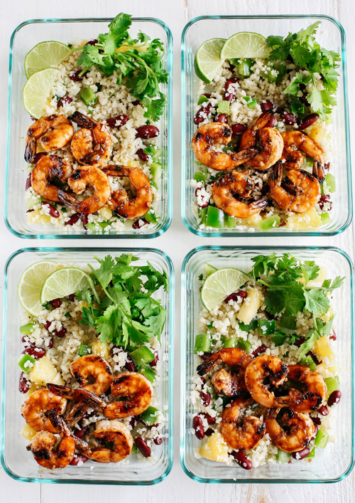 Caribbean jerk shrimp with cauliflower rice, lime slices and cilantro