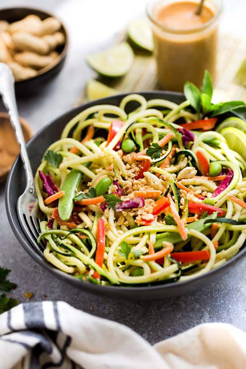 Asian zucchini noodle salad bowl with vegetables