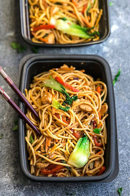 Healthy chicken lo mein and vegetables in a meal prep container