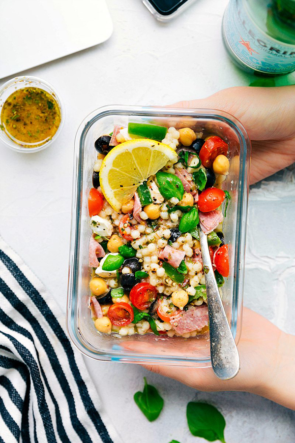Italian couscous salad in a glass container