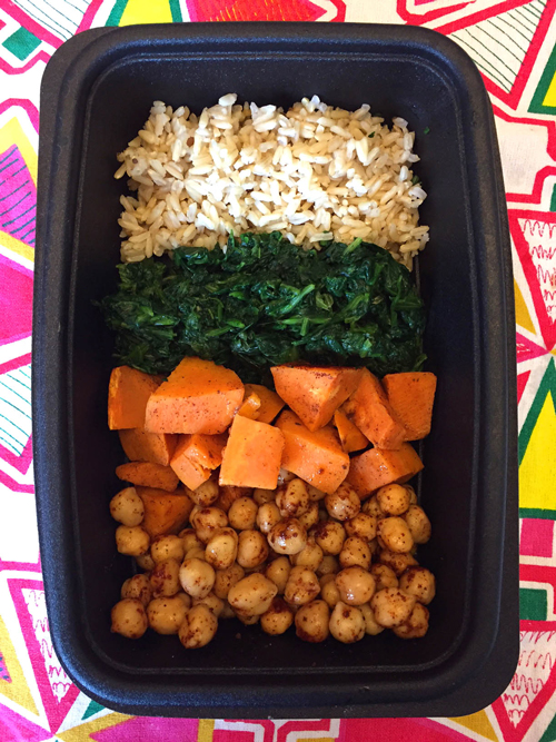 Vegan buddha bowl in a plastic meal prep container